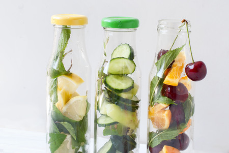 infusing: detox drinks for a healthy body, water infused with lemon and mint, kiwi and ougrtsah, orange and cherry concept food zdorovgo