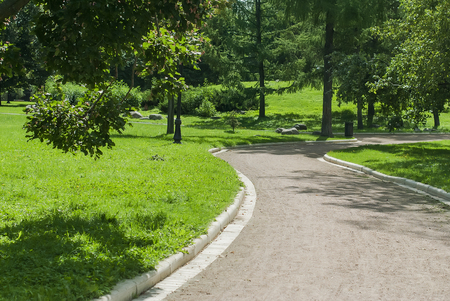 Public Park  , Bench and Alley in park outdoors in sunny summer day Stock Photo