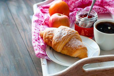 Breakfast with croissants, cup of black coffee and fruit Stock Photo