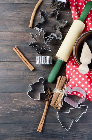 Gingerbread cookie dough and christmas cookie cutters. Baking holiday cookies. Christmas baking background .