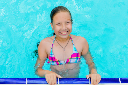 Active Little happy girl in swimming pool in aquapark, , summer holidays, joy and pleasure concept