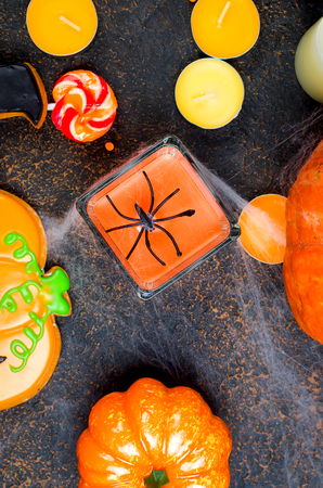 Halloween decorations,pumpkins, variety of gingerbreads,, spider and cobweb on black background, autumn holidays concept, copy space, top view, flat lay, Stock Photo