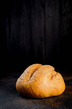 Circle Loaf of Rye  bread  on black background, healthy concept. Stock Photo