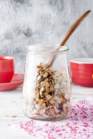 homemade granola in a jar, healthy tasty breakfast oatmeal with fruits and coffee in a cup, healthy eating concept, selective focus Stock Photo