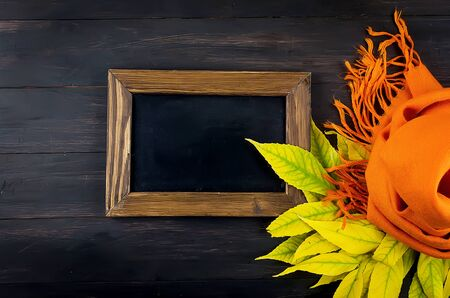autumn abstract still life with black frame, fall dried leaves on dark  background, autumn Happy thanksgiving concept, autumn holiday card design, copy space