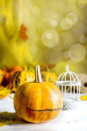 autumn abstract still life with Decorative Mini pumpkins with fall dried leaves, candle on dark  background, autumn Happy thanksgiving concept, autumn holiday card design, copy space