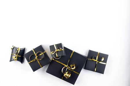 Christmas set with many gifts boxes in Wrapping Paper Gold, white  and Black colors , traditional decorations, mask, balls on white background. Copy space, Greeting card flatlay,