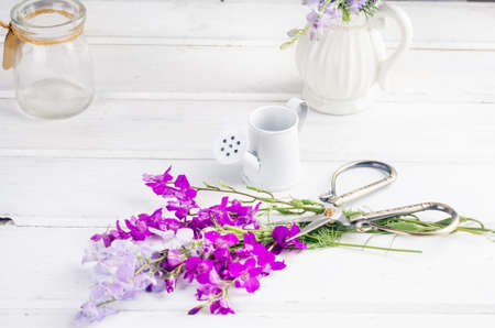 bouquet of purple wildflowers in a glass vase on a white table in the interior with a place for text. blank for postcards. spring concept