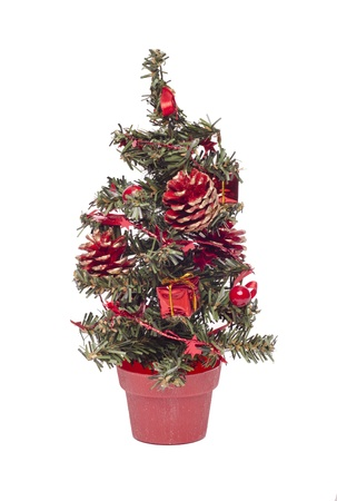 Small decorated christmas tree on white photo