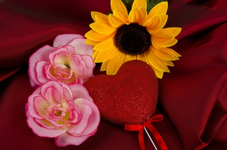 Pink flowers, yellow flower and heart on red Stock Photo - 12067834