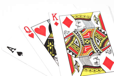 Three playing cards on white