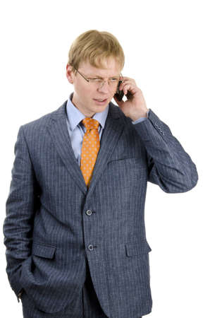 Image of young businessman speaking over the phone photo