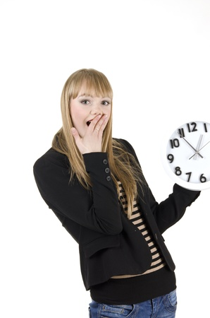 brigh: Portrait of shocked woman with alarm clock over white background