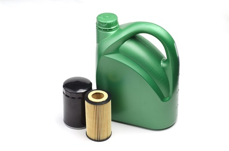 milliliters: Image of oil canister and oil filters isolated