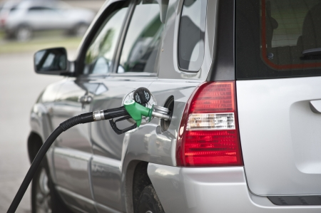 fuel economy: Image of gas refilling