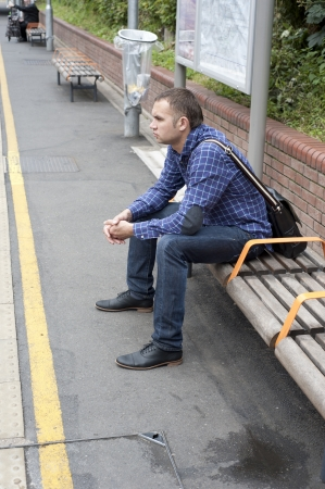 Image of young man waiting train photo