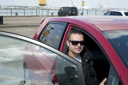 Image of young man in a car photo