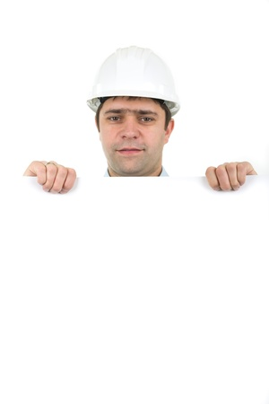 Image of worker wearing hard hat and holding empty banner photo