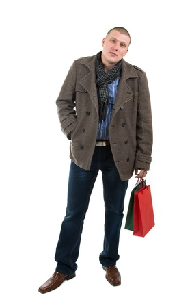 Image of young man holding shopping bags photo