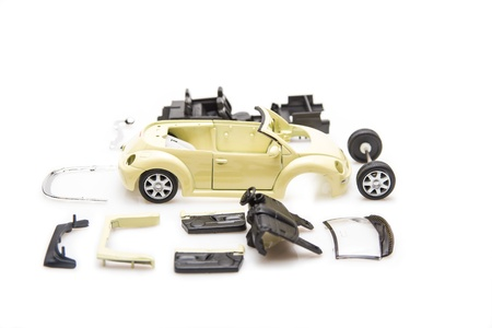 Bright image of toy car parts isolated on white photo