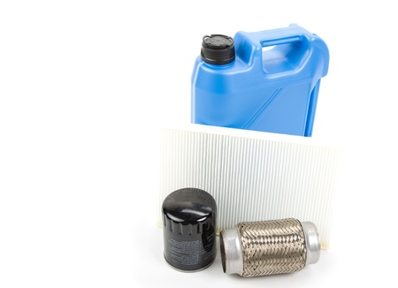 milliliters: Image of oil can with spare parts over white background Stock Photo