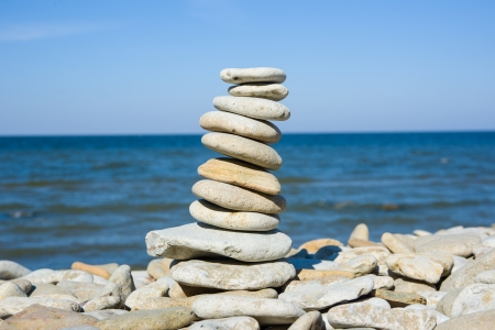 Image of balancing of pebbles each other on the seacoast photo