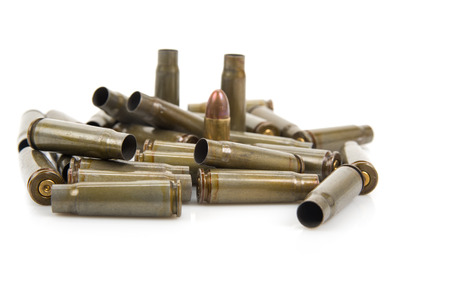 spent: Image of bullet casings isolated on white with selective focus