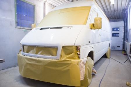 masking: Image of minivan prepared for painting Stock Photo