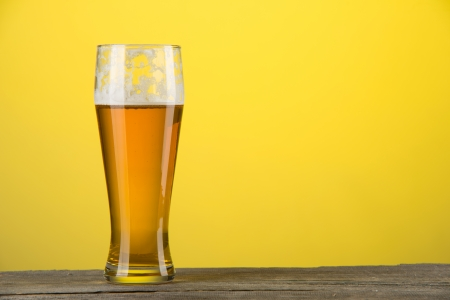 image of glass of beer over orange background photo