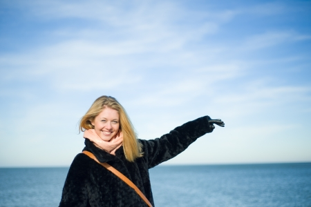 Image of beautiful girl with sky and sea  photo