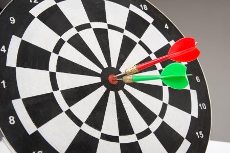 holed: image of dart board with darts  Stock Photo