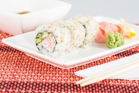 Image of Sushi closeup with sticks, sauce