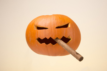 image of helloween with sigar pumpkin over yellow background Stock Photo