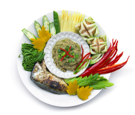 Fish mackerel dried paste chili spicy with fresh and boiled vagetable ,grill Thai mackerel.Thai cuisine,Thaispicy healthy food or dietfood top view isolated on white background