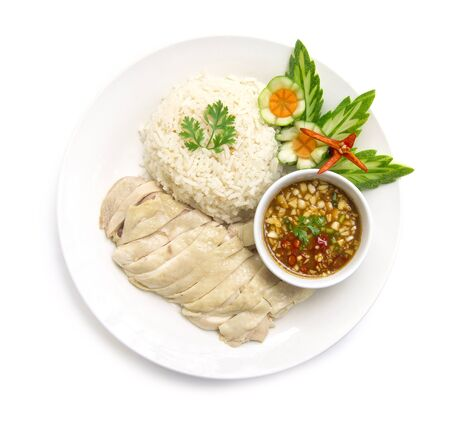Hainanese chicken rice steamed with soya sauce decorate cucumber carved fusion food Chinese and Thai mix style the best food popular in Thailand top view isolated on white background