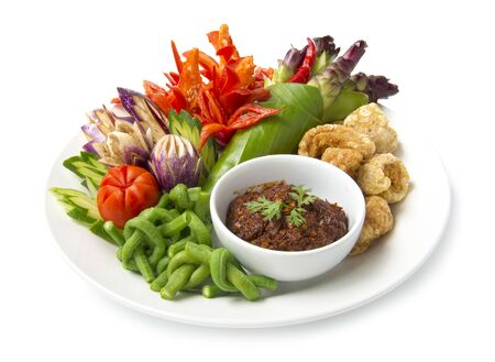 Red hot Chili paste spicy dipping sauce with fresh carved vagetable and crispy pork local Northern Thai style. The best popular of food in Thai cuisine, healthy food or dietfood side view