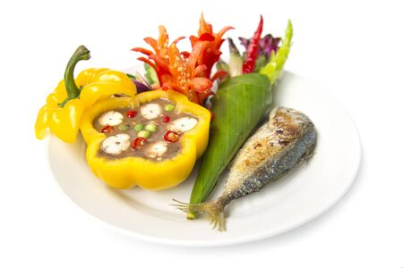 Thai spicy shrimp paste chili dipping sauce with grill mackerel fish and fresh carving vagetable Thai style.The best popular of food in Thai cuisine, healthy ealthy food or dietfood side view
