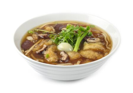 Fish maw with boiled quail egg and blood pork in red gravy soup Chinese style decorate Coriander, spring onions side view