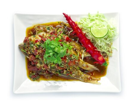 Fried Fish with sweet chili sauce Thai spicy food style decorate with vegetables chili top view Foto de archivo