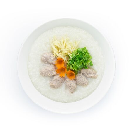 Congee Pork Rice Porridge served slice ginger and cutlet Celery. Asian Food breakfast decorate with carved carrots top view Stock Photo