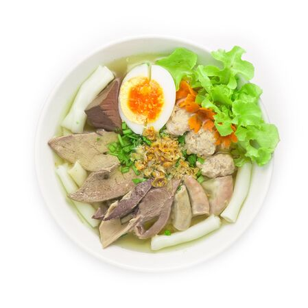 Vietnamese Rice Noodles Soup with Pork Blood, pork offal ,pork ball and Egg Asian Food fusion style breakfast, Lunch and dinner time served crispy Garlic and cutlet Celery top view