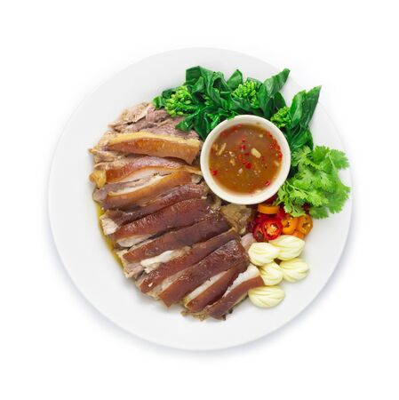 Stewed Pork Leg cutlet boiled in Sweet Brown Sauce Chinese food Herbs Style served with chili,garlic and Chinese kale decorate carved style Thaifood dish top view Archivio Fotografico - 147644938