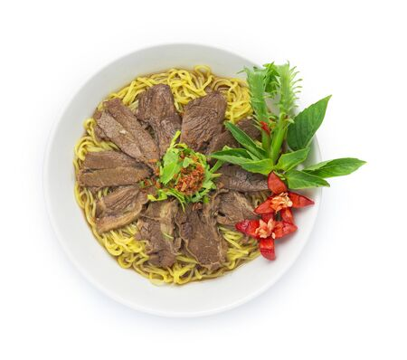 Egg Noodles with Braised Stewed Beef without soup (kuay taiw nuae toon) Thai food dish decorate with vegetables style side view