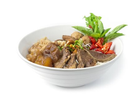 Vermicelli Noodles with Braised Stewed Mix Beef without soup (kuay taiw nuae toon) Thai food dish decorate with vegetables style side view 스톡 콘텐츠