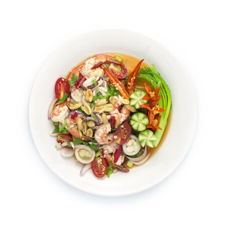 Spicy Salad Squids with Shrimp Seafood ingredient and Minced Pork, vegetable, Hot Spicy Tasty Thai Food fusion style decorate carved cucumber, chili peppers and spring onion top view