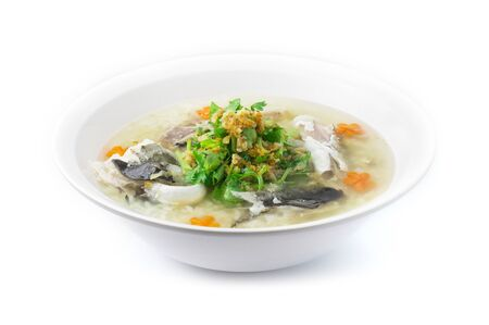 Rice Porridge  boiled with Head of Asian Seabass fish Cutlet cooking tasty Main Course Thai food fusion style decorate mix Chinese food style decorate with carved carrots and vegetable cutlet side view Stock Photo