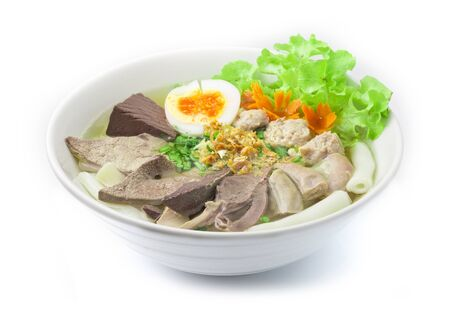 Vietnamese Rice Noodles Soup with Pork Blood, pork offal ,pork ball and Egg Asian Food fusion style breakfast, Lunch and dinner time served crispy Garlic and cutlet Celery side view Banco de Imagens