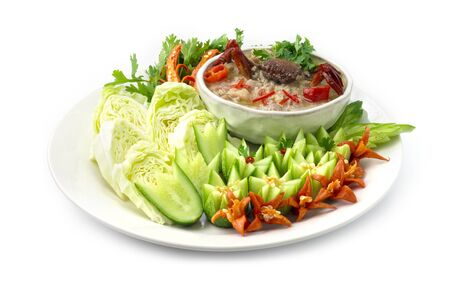 Chili Paste Soya Beans with minced Pork and Mud Crab in Coconut Milk Served with vegetables carved style. Thai food spicy dish side view