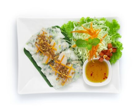 Rice flour Rolls Stuffed with ground pork and green onion on top with Vietnamese Pork Saucesage Served with sweet dipping sauces  Vietnamese Food style decorate with carved vegetables and chili healthy food top view