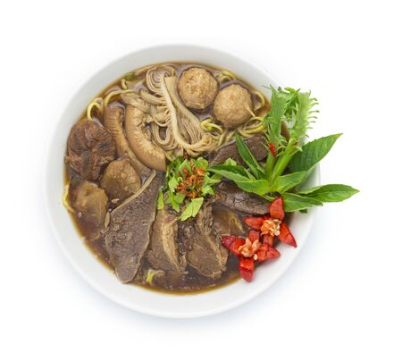 Thin Noodles with Braised Stewed Mix Beef in Chinese herb soup (kuay tiew nuae toon) Thai food dish decorate with vegetables style top view 스톡 콘텐츠